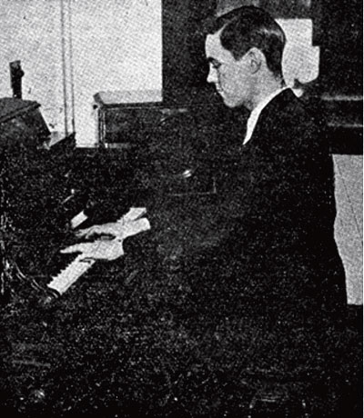 Winston Kock playing an early experimental design for an electric instrument